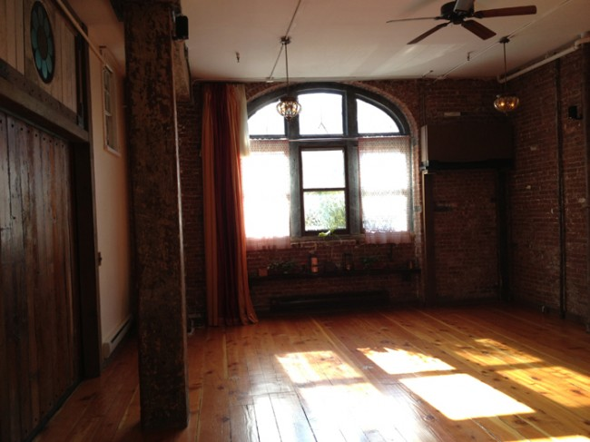 The main studio at Kula Yoga Project's Brooklyn location.