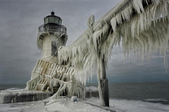 frozen lighthouse on Lake Michigan by thomas zakowski