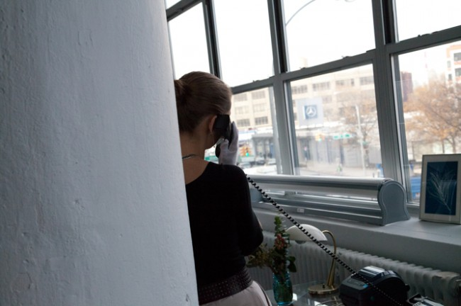 Judith Puckett-Rinella on the phone in her Long Island City studio.
