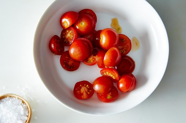 This lovely photo of perfectly sliced cherry tomatoes is by James Ransom via Food52.